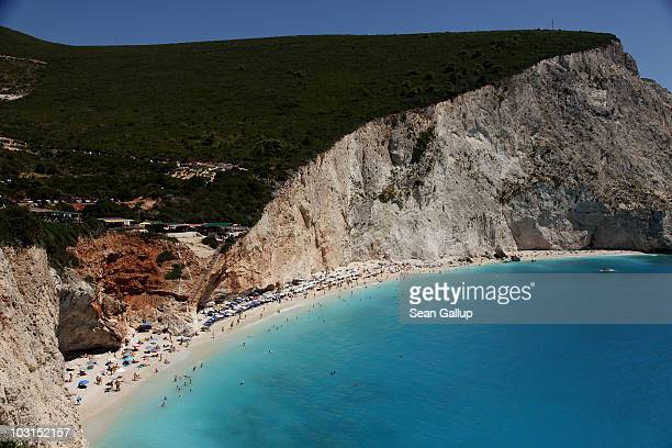 Bathers relax at the pebble and sand beach beside turquoise waters on July 27 2010 at Porto Katsiki on the island of Lefkada Greece Lefkada's west...