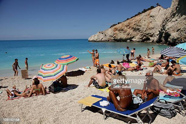Bathers relax at the pebble and sand beach on July 27 2010 at Porto Katsiki on the island of Lefkada Greece Lefkada's west coastline has among...