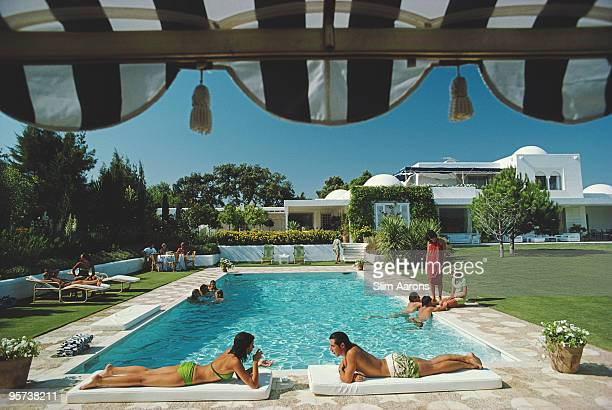 Bathers round a pool in Sotogrande Spain August 1975