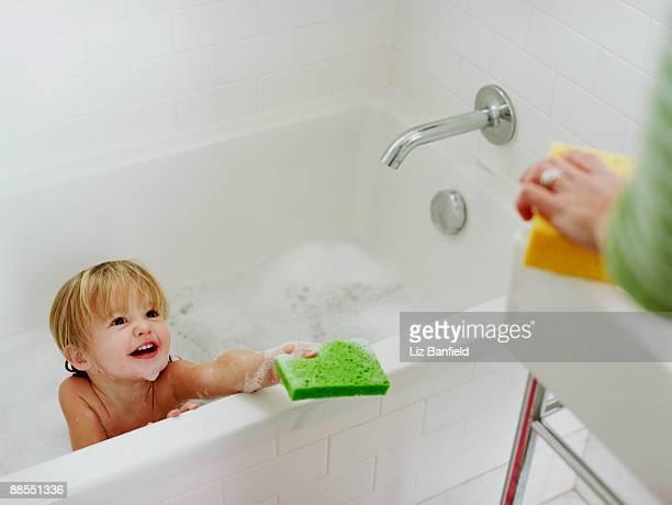 Bathing girl holding sponge