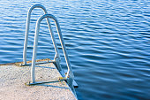 Bathing ladder at the end of a concrete pier.