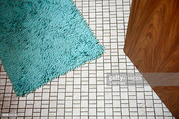 Bathroom floor with blue mat