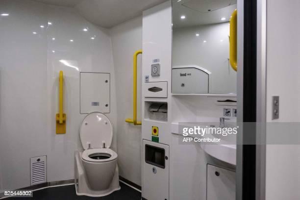 A bathroom is seen inside a GuangzhouShenzhenHong Kong Express Rail Link train in Hong Kong on August 2 2017 / AFP PHOTO / POOL / Billy HC Kwok