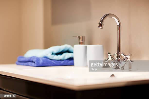 Bathroom sink with chrome faucet and towels