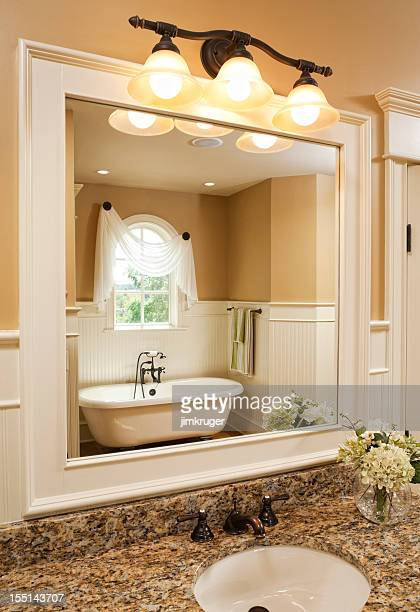 Bathroom vanity and clawfoot tub.