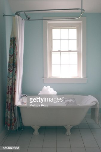Bathroom With Clawfoot Tub Filled With Bubbles Stock Photo Getty Images