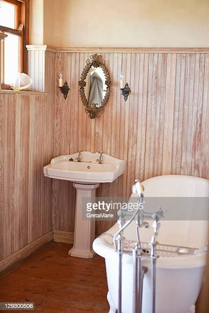 Bathroom with ornate tub and mirror