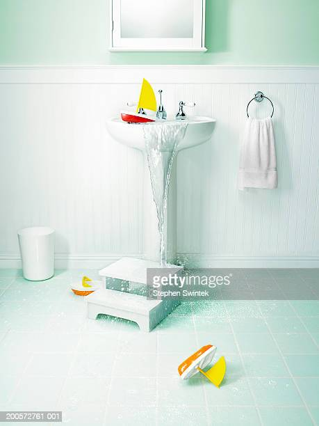 Bathroom with overflowing sink and children's toys