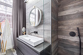 Bathroom with walk in shower and white countertop basin