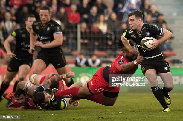 Bath's English flyhalf George Ford is tackled by RC Toulon's French centre Mathieu Bastareaud during the European Rugby Champions Cup rugby union...