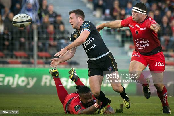 Bath's English flyhalf George Ford passes the ball as RC Toulon's French centre Mathieu Bastareaud attempts to tackle him during the European Rugby...