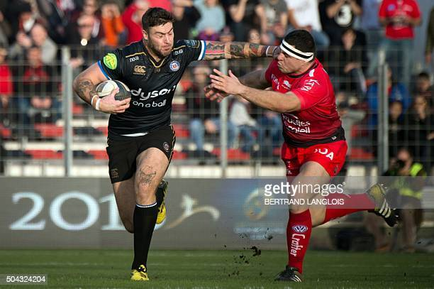 Bath's English wingh Matt Banahan evades RC Toulon's French hooker Guilhem Guirado during the European Rugby Champions Cup rugby union match RC...