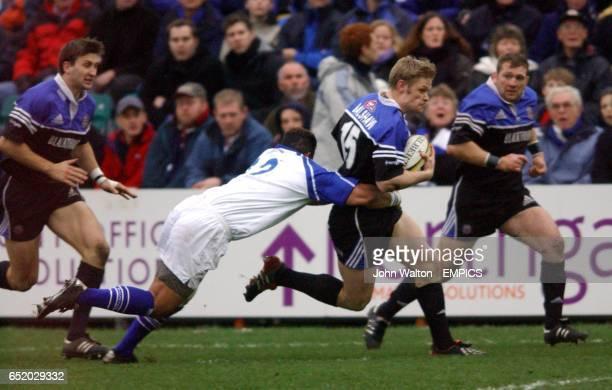 Bath's Iain Balshaw and Bridgend's Gareth Williams battle for the ball