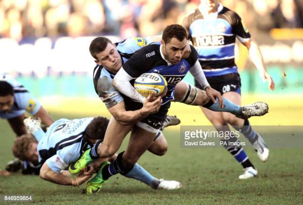 Bath's Olly Woodburn is tackled by Mark Wilson and Jimmy Gopperth of Newcastle during the Aviva Premiership match at the Recreation Ground Bath