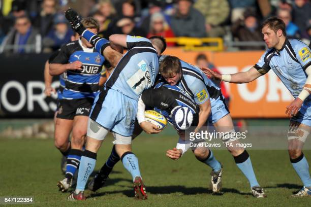 Bath's Pieter Dixon is upended by Newcastle's Grant Shiells and Adriaan Fondse
