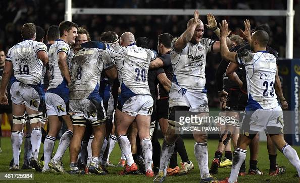 Bath's players celebrate after winning the European Rugby Union Champions Cup match between Toulouse and Bath on January 18 at the Ernest Wallon...