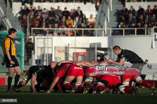 Bath's scrumhalf from England Chris Cook enters the ball into the scrum during the European Champions Cup rugby union match between RC Toulon and...