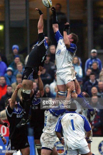 Bath's Steve Borthwick and Bridgend's Andy Moore are raised into the air to battle for the ball