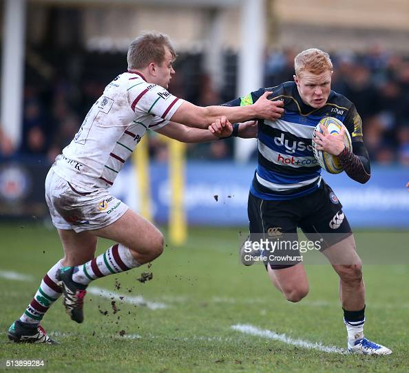 Bath's Tom Homer holds off London Irish's defender Scott Steele during the Aviva Premiership match between Bath Rugby and London Irish at The...
