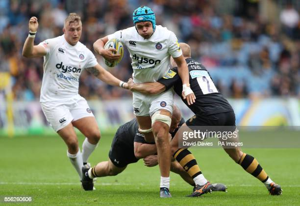Bath's Zach Mercer is tackled by Wasps Jake CooperWoolley and Tom Cruse during the Aviva Premiership match at the Ricoh Arena Coventry