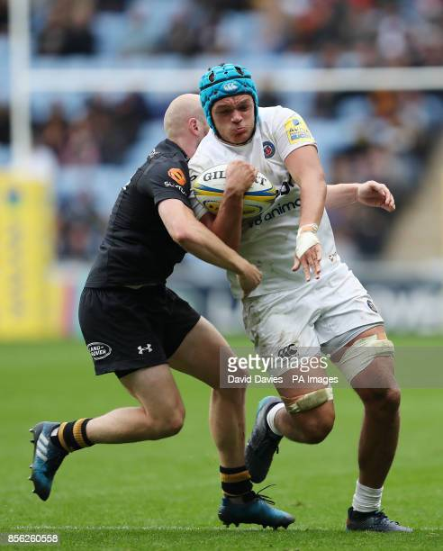 Bath's Zach Mercer is tackled by Wasps Joe Simpson during the Aviva Premiership match at the Ricoh Arena Coventry