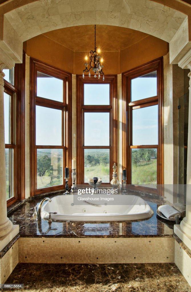 Bathtub in Opulent Bathroom with Bay Window