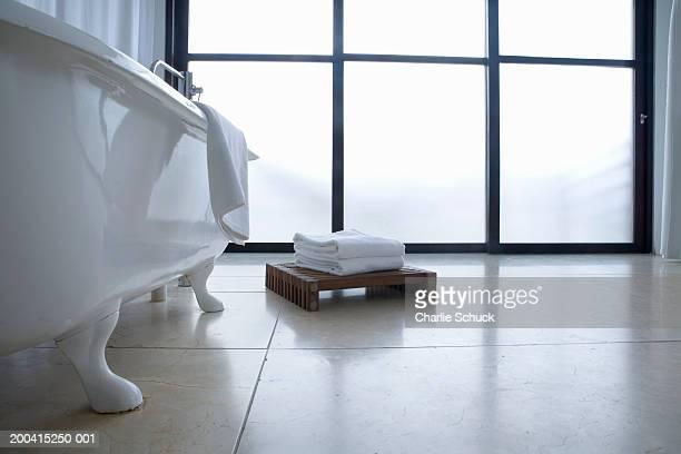 Bathtub next to window, low angle view