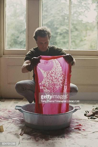 Batik and textile artist Noel Dyrenforth dyeing material 1965