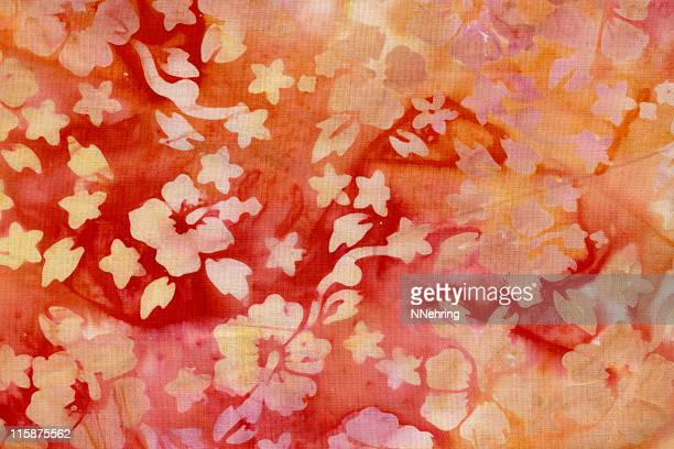 batik fabric with hibiscus in yellow and orange