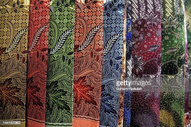 Batik prints are seen at a local batik shop in Surabaya on April 14 2012 in Java Indonesia
