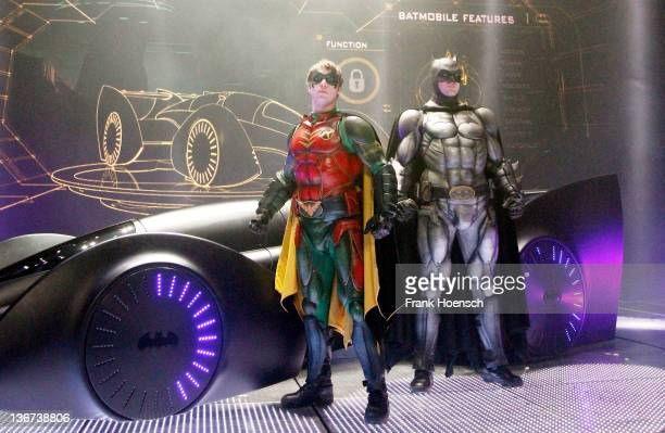 Batman and Robin pose in front of the Batmobil during the 'Batman Live Show' photocall at O2 World on January 11 2012 in Berlin Germany