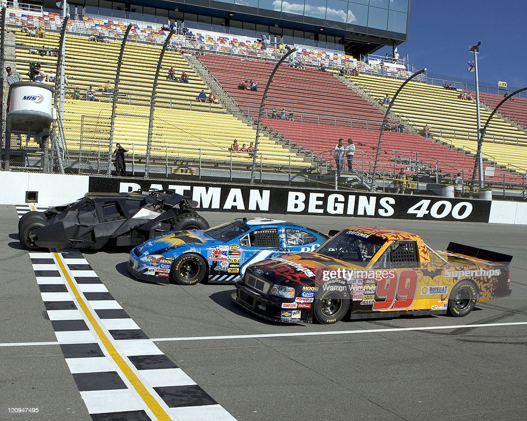 Batman beats <a gi-track='captionPersonalityLinkClicked' href=/galleries/search?phrase=Mark+Martin&family=editorial&specificpeople=204455 ng-click='$event.stopPropagation()'>Mark Martin</a> and Rickey Craven at the Michigan International Speedway, Brooklyn Michigan, June 17 2005