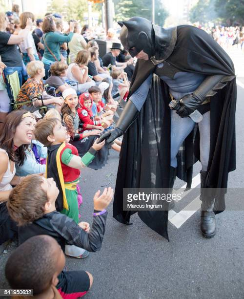 Batman greets a fan during the 2017 DragonCon Parade on September 2 2017 in Atlanta Georgia DragonCon is a multimedia is a multimedia convention held...