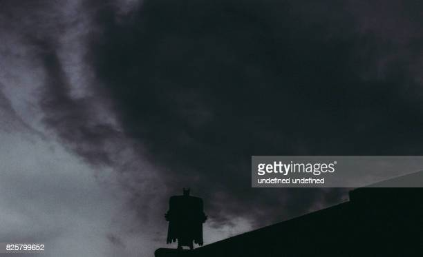 Batman standing on a stormy night