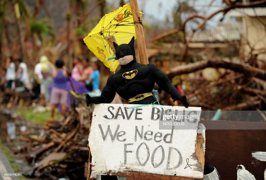 A batman stuffed toy is seen with a message that reads 'Save Bislig, We Need Food' in Palo, Leyte province on November 28, 2013. The Philippines' economy expanded 7.0 percent year-on-year in the third quarter, but a series of storms curbed growth and a devastating typhoon this month will slow momentum further, the government said on November 28.