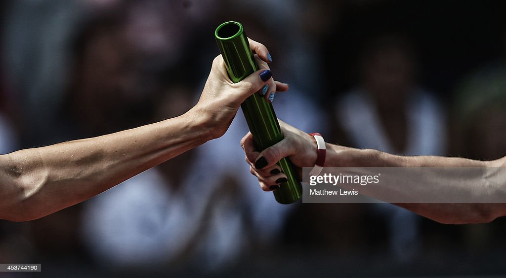 A baton is exchanged during the Womens 4x400m relay Final during day six of the 22nd European Athletics Championships at Stadium Letzigrund on August...