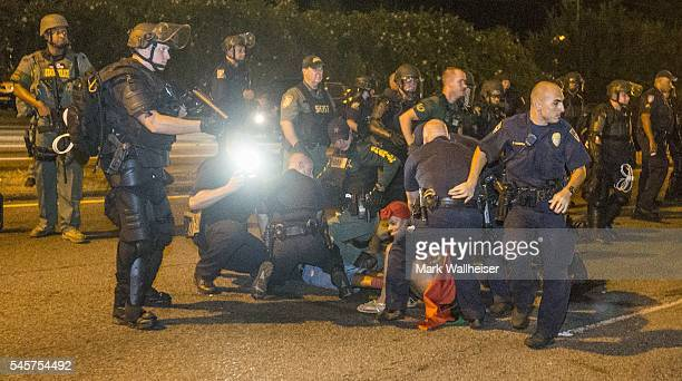 Baton Rogue police arrest protesters on July 9 2016 in Baton Rouge Louisiana Alton Sterling was shot by a police officer in front of the Triple S...