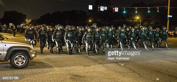 Baton Rouge police move in on protesters for a second night on July 9 2016 in Baton Rouge Louisiana Alton Sterling was shot by a police officer in...