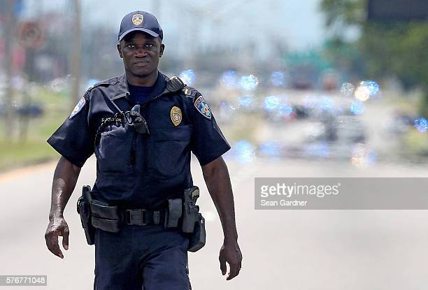 Baton Rouge Police officers patrol Airline Hwy after 3 police officers were killed early this morning on July 17 2016 in Baton Rouge Louisiana...