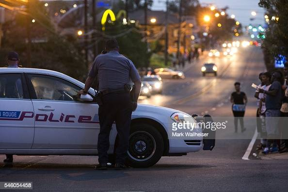 Baton Rouge police redirect traffic away from a protest march that resulted in scores of arrests after a march on July 10 2016 in Baton Rouge...