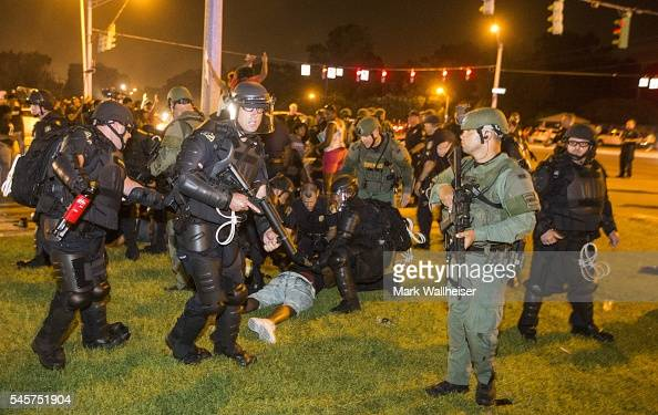 Baton Rouge police rush the crowd of protesters and start making arrest on July 9 2016 in Baton Rouge Louisiana Alton Sterling was shot by a police...