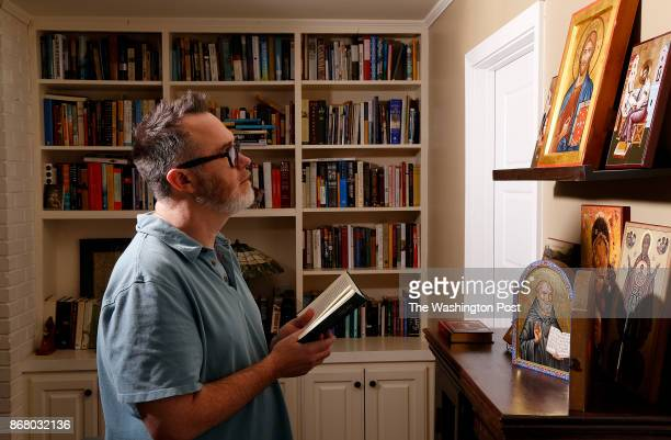 Baton Rouge LA Sept 11 2017 New Orleans Louisiana United States Author and blogger Rod Dreher takes a moment for prayer in front of a collection of...