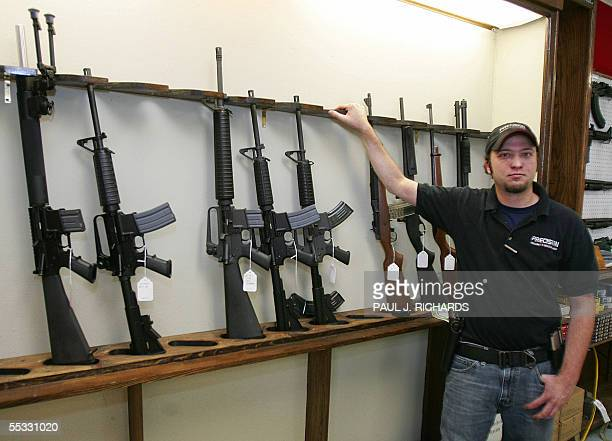 TO GO WITH AFP STORYUSWEATHERGUNS by Charles Hoskinson Tony Fazzio one of the salesman at Precision Firearms Indoor Range in Baton Rouge Louisiana...