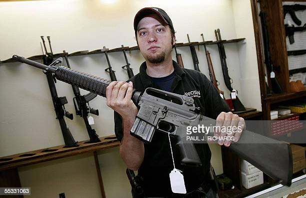 TO GO WITH AFP STORYUSWEATHERGUNS by Charles Hoskinson Tony Fazzio a salesman at Precision Firearms Indoor Range in Baton Rouge Louisiana...