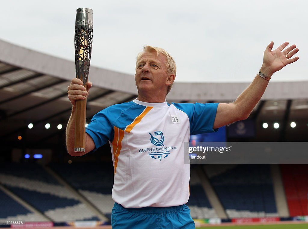 Batonbearer 021 Gordon Strachan carries the Glasgow 2014 Queen's Baton at Hampden Park on July 22, 2014 in Glasgow, Scotland. Scotland is nation 70 of 70 nations and territories the Queen's Baton will visit.