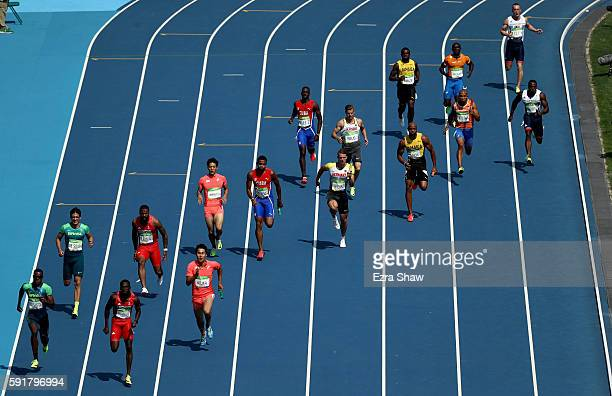 Batons are passed to the final runners in the second heat of round one of the Men's 4 x 100m Relay on Day 13 of the Rio 2016 Olympic Games at the...