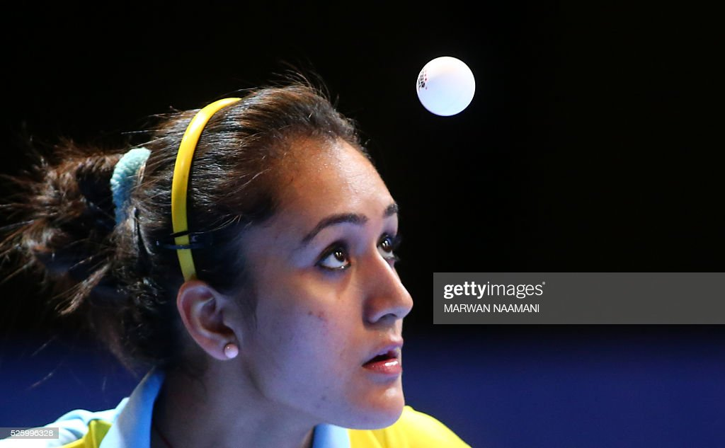 Batra Manika of India serves the ball to Lee Zion of Korea during their women's singles quarter final table tennis match in the ITTF Nakheel Table Tennis Asian Cup, in Dubai, on April 29, 2016. / AFP / MARWAN
