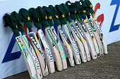 Bats and caps are placed outside the Pakistan dressing room in memory of Australian cricketer Phillip Hughes who died as a result of head injuries...