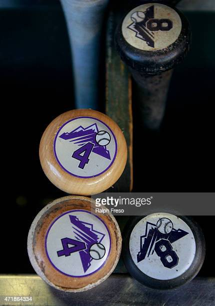 Bats of Nick Hundley and Michael McKenry of the Colorado Rockies sit in the dugout before the start of a MLB game against the Arizona Diamondbacks at...