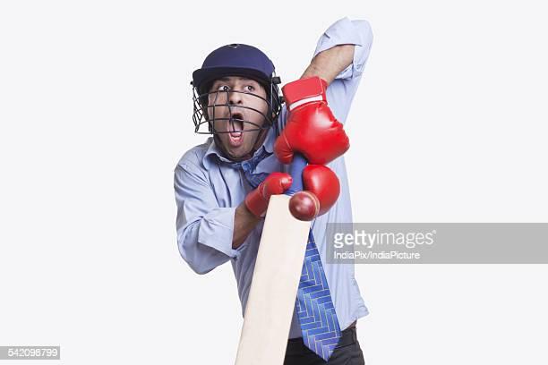 Batsman hitting ball over white background